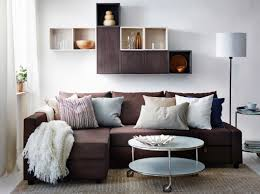 a modern living room with a brown friheten sofa bed valje wall