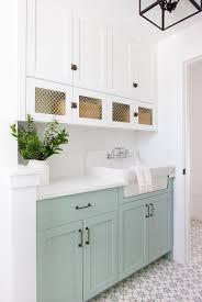 green lower white kitchen cabinets white laundry cabinets and green lower laundry