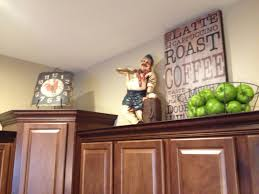 top of kitchen cabinet decor ideas ideas to decorate above kitchen cabinets amys office