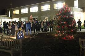 families gather to light campus christmas tree villa maria