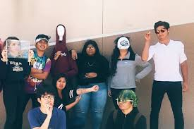 Me Me Images - high school seniors celebrate meme day with costumes