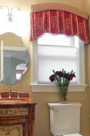 very unusual box pleated valance with an arched cornice top the