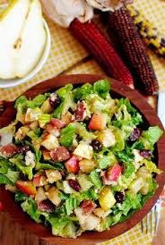 autumn chopped salad with pears cranberries pecans bacon and