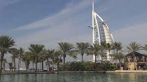 burj al arab hotel palm tree reflection water blue sky luxurious