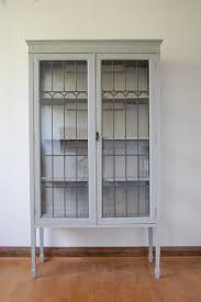 white painted wooden display cabinet come with clear glass door