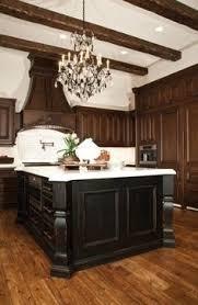 elegant distressed black kitchen cabinets with hardwoord floors