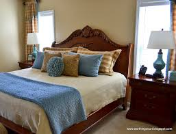 bedroom blue and white bedside lamps brown wood headboard white