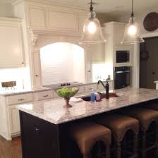 kitchen with painted brick backsplash west highland white cabinets