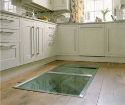 man builds window in the floor of the kitchen leads to a secret