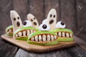 gourmet halloween treats scary edible halloween treat apple cyclop mouth with peanut butter