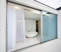 gorgeous bathroom view behind modern sliding door design with wide