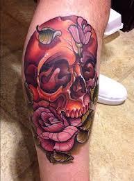 new of sugar skull tattoo and pink rose tattoo at leg