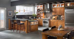 ideas for above kitchen cabinets a kitchen of oak and warm toffee is enhanced by aluminum glass