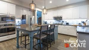 five ways to make your kitchen family friendly kitchen bath crate combining spaces the kitchen above swapped our their dining table and small island for a large island table combo we love this new addition because it