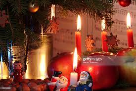 Christmas Decoration Santa Claus by Burning Candles Red Apples Nuts Christmas Decoration Santa Claus