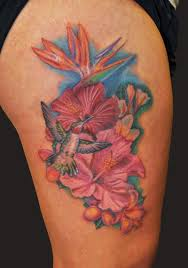 hawaiian flowers tattoo on biceps tattoos book 65 000 tattoos