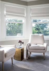 bay window bedroom furniture bay window siiting area with modern white chairs and brass accent
