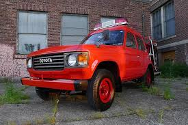 red land cruiser toyota land cruiser is a serious go anywhere firetruck
