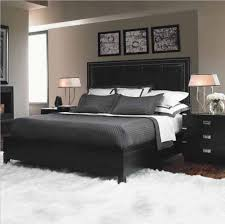 white fur rug and black leather headboard for contemporary bedroom