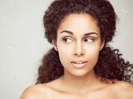 hair i woman s chin sideways portrait of a sensual young african woman casting a sideways