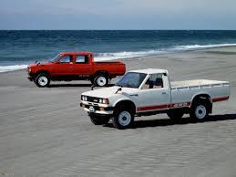 yellow nissan truck nissan pickup qygjxz