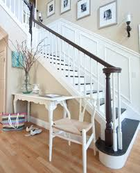 entry staircase white spindles with dark stained wood railing and