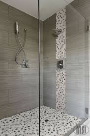 best ideas about wall tiles design pinterest geometric love the pebble glass waterfall vertical design and matching shower floor elongated striated large tilewall