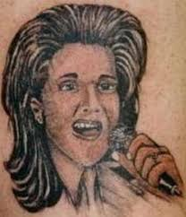 guess who these celebrity statues and tattoos are supposed to be