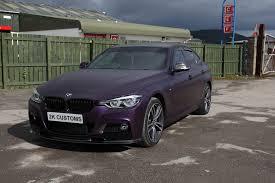 dark green bmw epic bmw 3 series full car wrap in black purple vinyl with black