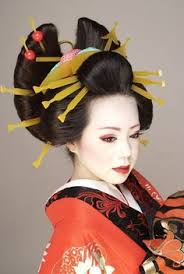 maiko bowing maikos wear several elaborate hair ornaments or