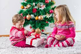 happy children open christmas presents on the floor and tree happy children open christmas presents on the floor and tree with new year decoration at home