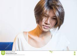 sad short hair asian chinese in vintage tone stock photo