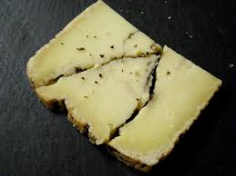 italian truffle cheese tales from the fairway cheese counter moliterno laced with black