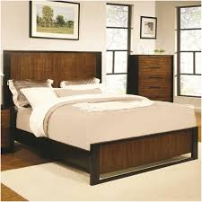 brown wooden low profile bed frame with headboard and black base