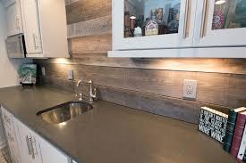 wood backsplash kitchen closeup of back bar with new granite countertops reclaimed wood