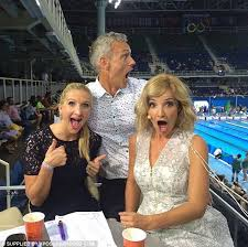 rebecca adlington giggles as mark foster flashes his chest to show