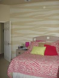 paint a large zebra print on the wall and go over with a rustic