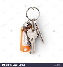keys and key fob hanging on nail against white background