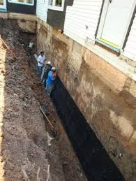 an exterior foundation drain and waterproof membrane is the best