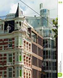 dutch baroque architecture and modern buildings in amsterdam stock