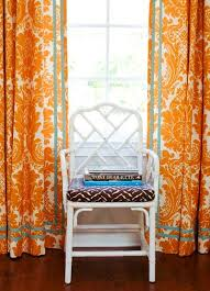 Orange And White Curtains Room To A Visually Entertaining Family Room Schumacher