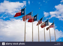 Texas Flag Image American Flags And Texas Flags Flying In Dallas Stock Photo