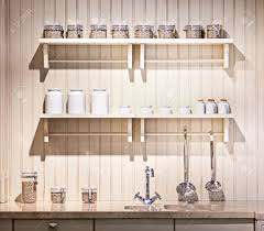beautiful old fashioned kitchen with shelves stock photo picture