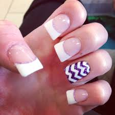 white french tips with a purple and white design on acrylic nails