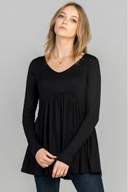 long sleeve babydoll top featuring a v neck and ruffles