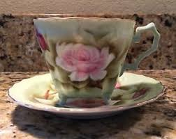 lefton china pattern vintage lefton china tea cup saucer green pink pattern footed