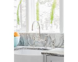 a 100 year old boston home kitchen remodel boston design guide details in the goose necked chrome silver perrin and rowe faucet and white porcelain apron front rohl farmhouse sink