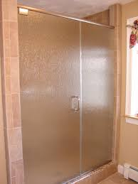 shower stalls with glass doors bathroom light over mirror