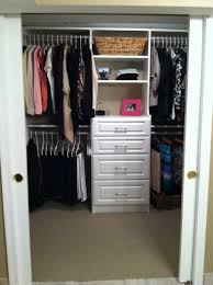 white wooden closet with some racks and white cloth hook connected