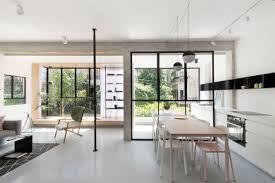 Minimalist Apartment Revamp Creates Open Minimalist Apartment With Bold Black Accents
